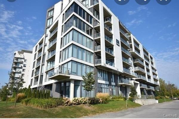 BEAUTIFUL 3 1/2 CONDO LUMIERE IN THE HEART OF LAVAL
