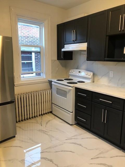 Fully renovated 4 large bedrooms plus large living room & 2 full bathrooms ideal for 4 students.